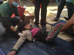 Young girl on stretcher, UNICEF-supported hospital Dhadang District