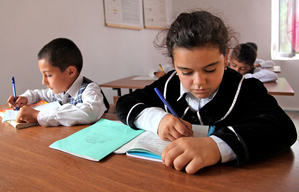 Guliyeva Saida, 8 writing in class in the UNICEF supported primary school